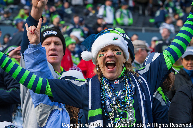 Seattle Seahawks fans cheer during their game against the Green Bay Packers during the NFC Championship game at CenturyLink Field in Seattle, Washington on January 18, 2015.  The Seattle Seahawks beat the Green Bay Packers in overtime 28-22 for the NFC Championship Seattle.  ©2015. Photo by Jim Bryant, All Rights Reserved.