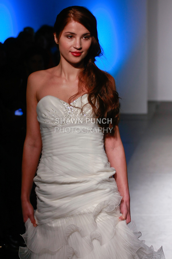 Model walks the runway in a Bridal gown by Seckin Ilker, for the Seckin Ilker Haute Couture collection, during Nolcha Fashion Week: New York February 2012.