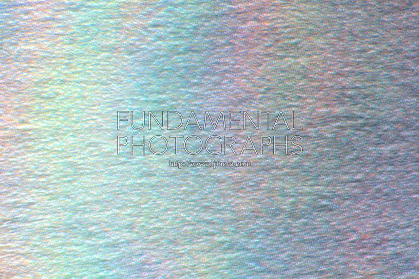PHOTOMICROGRAPH OF SURFACE OF COMPACT DISC<br /> CD-ROM at 400x<br /> Shows pattern of pits and plateaus and spectral colors. Compact discs are made of rigid PVC (polyvinyl chloride).