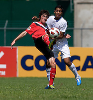 Joshua Nieto (19) of Honduras has the ball cleared away from him by Jay Chapman (16) of Canada during the group stage of the CONCACAF Men's Under 17 Championship at Catherine Hall Stadium in Montego Bay, Jamaica. Canada tied Honduras, 0-0.