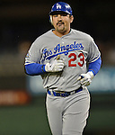 20 September 2012: Los Angeles first baseman Adrian Gonzalez returns to the dugout during a game against the Washington Nationals at Nationals Park in Washington, DC. The Nationals defeated the Dodgers 4-1, clinching a playoff birth: the first time for a Washington franchise since 1933. Mandatory Credit: Ed Wolfstein Photo