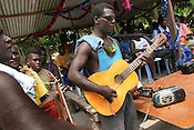 "The band warms up, with their guitars and cassette recorders which act as amplifiers, at ""school closing"" festivities on Han Island, Carterets Atoll, Papua New Guinea, on Monday, Dec. 11, 2006."
