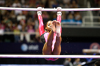 Gabrielle Douglas competes on the uneven bars during the 2012 US Olympic Trials competition at HP Pavilion in San Jose, California on June 29th, 2012.