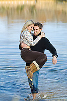 Man carrying girl out of a lake in East Hampton, NY