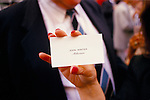 FEMALE'S HAND, WITH RED FINGERNAIL POLISH, HOLDING & DISPLAYING, 'JOHN WINTER - MILLIONAIRE' CALLING CARD, AT BELGRAVIA STREET PARTY, LONDON,
