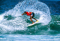 Sunny Garcia (HAW) on his way to a 2nd place finish in the 1997 Coke Surf Classic at Narrabeen beach, Sydney, Australia.  Photo: joliphotos.com