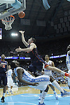 16 February 2013: Virginia's Joe Harris (center) is fouled by North Carolina's P.J. Hairston (below) as he tries to make a layup. The University of North Carolina Tar Heels played the University of Virginia Cavaliers at the Dean E. Smith Center in Chapel Hill, North Carolina in a 2012-2013 NCAA Division I and Atlantic Coast Conference men's college basketball game. UNC won the game 93-81.