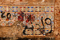 """Detail of mosaics covered with painted graffitis,  old city, Portuguese Fortified city of Mazagan, El Jadida, Morocco. El Jadida, previously known as Mazagan (Portuguese: Mazag""""o), was seized in 1502 by the Portuguese, and they controlled this city until 1769. Picture by Manuel Cohen"""