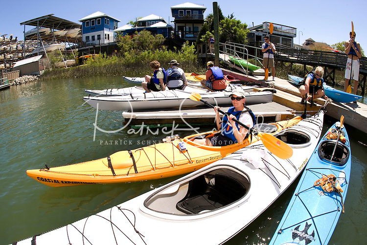 A group of kayakers wait to launch their boats in Charleston, SC.