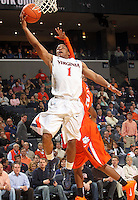 Feb. 2, 2011; Charlottesville, VA, USA; Virginia Cavaliers guard Jontel Evans (1) shoots in front of Clemson Tigers guard Demontez Stitt (2) during the game at the John Paul Jones Arena. Virginia won 49-47. Mandatory Credit: Andrew Shurtleff