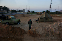 Near Tarhouna, Libya, March 23, 2011.In this image taken during an organized trip by the Libyan authorities, soldiers stand guard at one of many check-points along the road from Tripoli to Tarhouna.