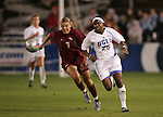 FSU's Viola Odebrecht (7) and UCLA's Danesha Adams (25) chase after the ball. The UCLA Bruins defeated the Florida State University Seminoles 4-0 at Aggie Soccer Stadium in College Station, Texas, Friday, December 2, 2005.