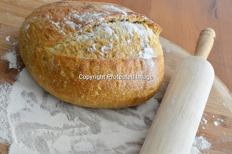 Stock photo of bread flour and roller pin