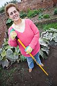 Older woman gardening in a garden. MR