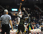 "Ole Miss' Nick Williams (20) vs. Coastal Carolina's El Hadji Ndieguene (11) and Michel Enanga (12) at the C.M. ""Tad"" Smith Coliseum in Oxford, Miss. on Tuesday, November 13, 2012. (AP Photo/Oxford Eagle, Bruce Newman)"
