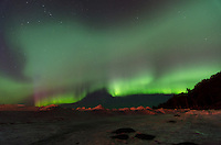 An impressive Northern Lights display over the ice mountains of the Lake Superior shoreline. Marquette, MI