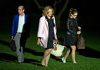 From left to right: Senior Advisor Stephen Miller, Deputy National Security Advisor K. T. McFarland, and White House Director of Strategic Communications Hope Hicks <br /> walk on the South Lawn of the White House in Washington, DC after returning with United States President Donald J. Trump from a weekend trip to the Trump National Golf Club in Bedminster, New Jersey on Sunday, May 7, 2017.<br /> Credit: Ron Sachs / Pool via CNP /MediaPunch