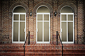 Three doors on a brick building in Abita Springs Louisiana