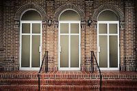 Three doors on a brick building in Abita Springs Louisiana