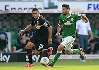 FUSSBALL   1. BUNDESLIGA   SAISON 2013/2014   2. SPIELTAG SV Werder Bremen - FC Augsburg       11.08.2013 Raul Bobadilla (li, FC Augsburg) gegen Mehmet Ekici (re, SV Werder Bremen)