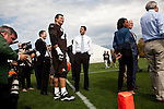 Republican vice presidential candidate Rep. Paul Ryan, center, talks with Cleveland Browns player Joe Thomas, left, on the Cleveland Browns practice field in Berea, Ohio, October 17, 2012.