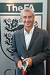 PR photograph of Wales and Liverpool legend Ian Rush at Wembley Stadium in front of an England FA badge