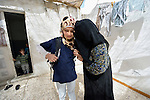 Rufiedah, who asked that her last name not be used for security reasons, kisses her daugher before she walks to school in Madaba, a sprawling Palestinian refugee camp in Jordan that has grown in recent years with the arrival of women like Rufiedah, who came to Jordan in 2014 from a village near Damascus, Syria. As a result, the more than 25,000 Palestinians in Madaba have been joined by more than 6,000 Syrians. The  Department of Service for Palestinian Refugees of the Middle East Council of Churches, a member of the ACT Alliance, provides a variety of services here, including medical care.