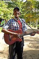 Black Nicaraguan man playing the guitar and singing on Big Corn Island, Nicaragua