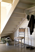 Although the house itself is contemporary it is furnished with an eclectic collection of antiques