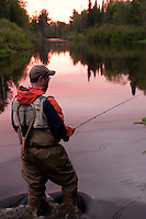 A fly fisherman on the Escanaba River near Gwinn Michigan.
