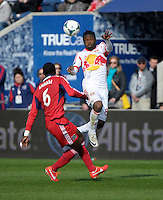 New York forward Peguy Luyindula (88) leaps for the ball in front of Chicago defender Jalil Anibaba (6).  The Chicago Fire defeated the New York Red Bulls 3-1 at Toyota Park in Bridgeview, IL on April 7, 2013.