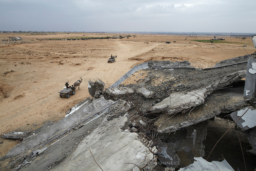 Carts remove rubble from Yasser Arafat International Airport in southern Gaza. Local men, women, and children work here daily to gather aggregates for use in concrete, which under the blockade is severely lacking in Gaza.