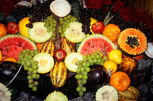 Porto Seguro, Bahia State, Brazil; display of fruit; melon, watermelon, grapes, papaya, cacau, pear, apple, coconut etc.