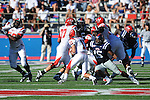Jacksonville State quarterback Coty Blanchard (11)  is tackled by Ole Miss linebacker Joel Kight (15)at Vaught-Hemingway Stadium in Oxford, Miss. on Saturday, September 4, 2010.