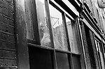 Whitechapel London. 1978<br /> In a road just off Brick Lane, a lone Asian woman stares out of her flat window. There had been reports in the press that many new immigrants to Britain, and in particular Bangladeshi women were being kept under lock and key by their men folk. They didn&rsquo;t speak the language and were rarely allowed out of their homes