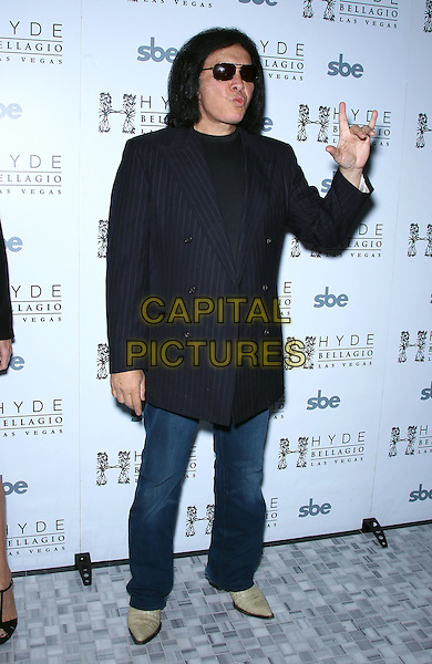 Gene Simmons.Nick Simmons celebrates his 23rd birthday with family jewels and performance at Hyde Bellagio, Las Vegas, Nevada, USA, 9th March 2012..full length pinstripe jacket blue jeans  navy hand sunglasses waving gesture .CAP/ADM/MJT.© MJT/AdMedia/Capital Pictures.