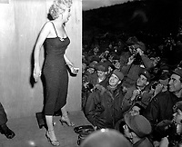Marilyn Monroe, motion picture actress, appearing with the USO Camp Show, &quot;Anything Goes,&quot;  poses for the shutterbugs after a performance at the 3rd U.S. Inf. Div. area.  February 17, 1954.  Cpl. Welshman.  (Army)<br /> NARA FILE #  111-SC-452342<br /> WAR &amp; CONFLICT BOOK #:  1466
