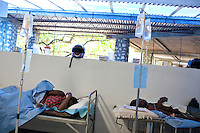 Cholera patients lie on gurneys where they receive hydration through an I.V. on Thursday, October 28, 2010 in Deschapelles, Haiti.