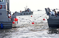 A vessel used as a tender to deliver salmon to a cannery is tied up to the dock in Egegik, Alaska in July 1998.  Bristol Bay has the largest sockeye salmon run in the world.