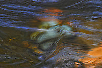 Water rushing over river rocks at Pinkham Creek, Kootenai National Forest, Montana