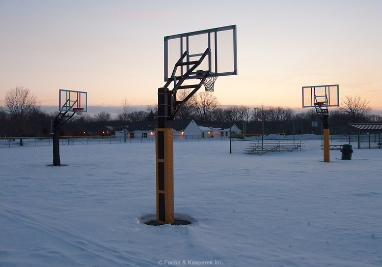 Basketball courts sit dormant on a frigid evening.