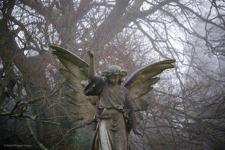 Stone angel in graveyard