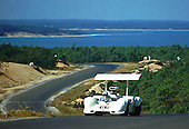 Winging over the dunes, Jim Hall and his Chaparral 2G crest the climbing last turn at the old Bridgehampton road course on New York state's Long Island during practice for the 1968 Can-Am. Built on a 2E chassis first raced in 1966 with a small block, the 2G had a Big Block Chevy engine and, this year, super-wide tires. It was at this race that Hall was able to pass both factory McLarens and lead five glorious laps.