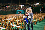OHIO graduate Angela Huffman holds her child Davin at fall commencement. Photo by Ben Siegel