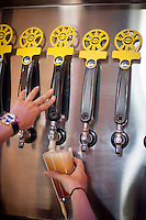 Copyright Justin Cook   July 24, 2013<br /> <br /> A bartender pours a beer at Crank Arm Brewery in Raleigh, N.C.