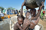 Girls bathe inside a United Nations base in Juba, South Sudan, where some 34,000 people have sought protection since violence broke out in December 2013. More than 112,000 people currently live on UN bases in the war-torn country, most of them afraid of tribally targeted violence.