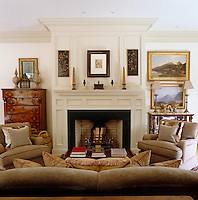 The drawing room fireplace was marbleised by English painter Dawn Reader and houses neo-classical obelisks and urns, all fabrics and furniture are by Nicholas Haslam