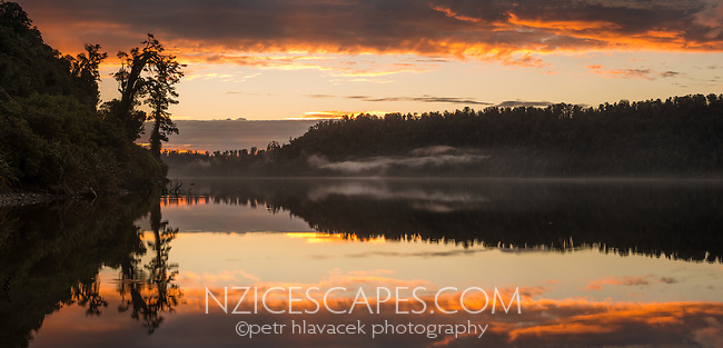 Sunset over Lake Wahapo with reflections, West Coast, Westland Tai Poutini National Park, UNESCO World Heritage Area, South Westland, New Zealand, NZ