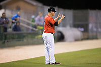 Kannapolis Intimidators manager Justin Jirschele (9) lets the runner know there is only one out during the game against the Lakewood BlueClaws at Kannapolis Intimidators Stadium on April 8, 2017 in Kannapolis, North Carolina.  The BlueClaws defeated the Intimidators 8-4 in 10 innings.  (Brian Westerholt/Four Seam Images)