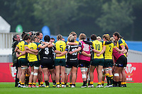 The New Zealand and Australia teams huddle together after the match. FISU World University Championship Rugby Sevens Women's 9th/10th place match between New Zealand and Australia on July 9, 2016 at the Swansea University International Sports Village in Swansea, Wales. Photo by: Patrick Khachfe / Onside Images
